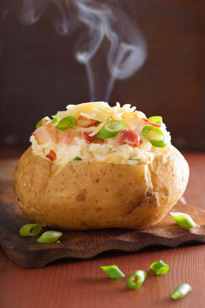 jacket potato: baked stuffed potato in jacket with bacon and cheese