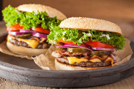 red food: bacon cheese burger with pickles tomato onion Stock Photo