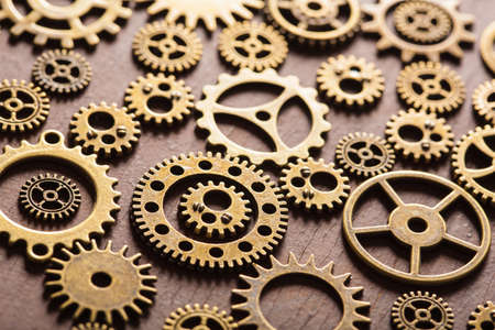 mechanical energy: steampunk mechanical cogs gears wheels on wooden background