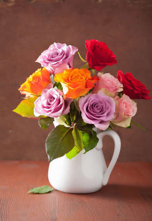vase: beautiful colorful rose flowers bouquet in vase