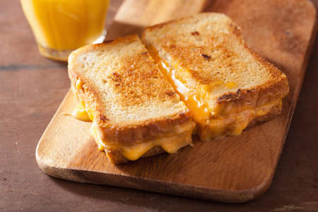 melted cheese: homemade grilled cheese sandwich for breakfast Stock Photo