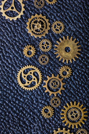 leathern: steampunk mechanical cogs gears wheels on leathern background Stock Photo