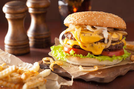 cheeseburger with fries: double cheeseburger with tomato and onion Stock Photo