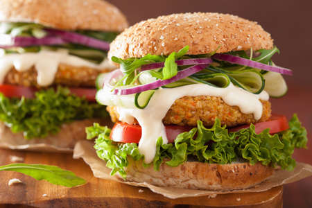veggies: veggie carrot and oats burger with cucumber onion tomato Stock Photo