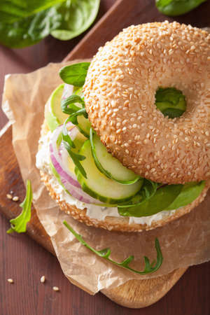 cream cheese: avocado sandwich on bagel with cream cheese onion cucumber arugula
