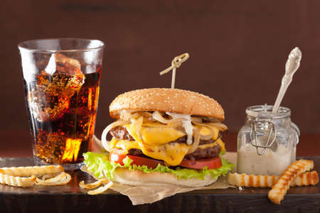 onion: double cheeseburger with tomato and onion Stock Photo