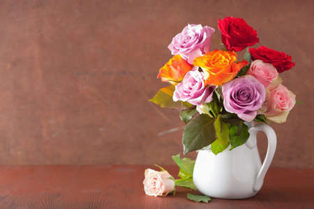vase of flowers: beautiful colorful rose flowers bouquet in vase