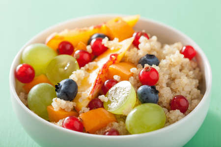 grains: healthy breakfast quinoa with fruits berry nectarine blueberry grape Stock Photo