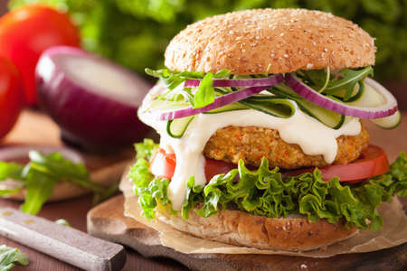veggie carrot and oats burger with cucumber onion tomato Фото со стока