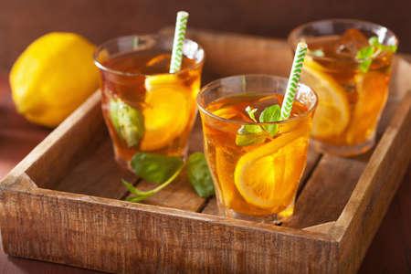ice lemon tea: ice tea with lemon and mint on dark rustic background