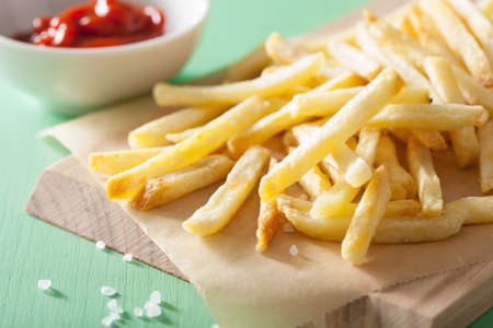 fry: french fries with ketchup over green background