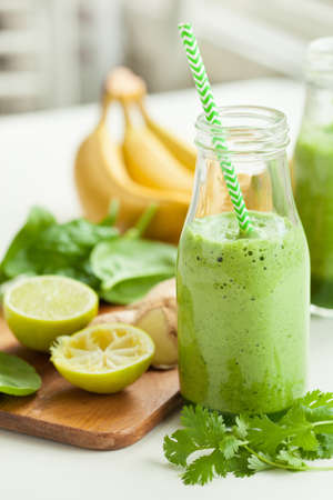 cilantro: healthy green spinach smoothie with cilantro lime banana ginger Stock Photo