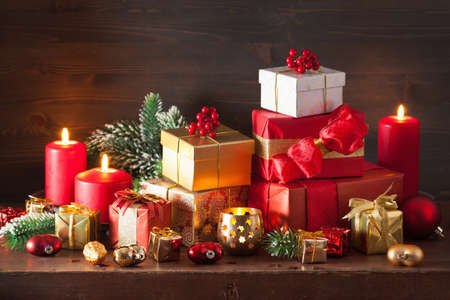 red and golden christmas gift box and decoration lantern candle stock photo 63694511