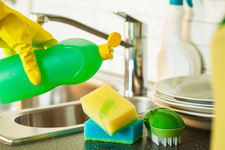 dish: pouring dishwashing liquid on sponge kitchen wash cleaning