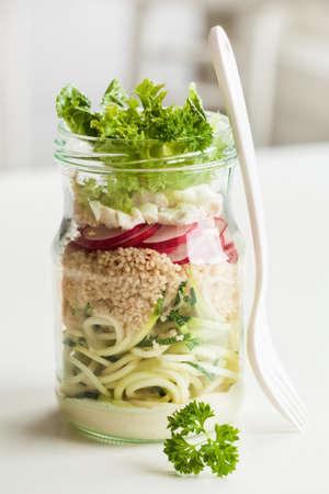 spiralized: vegetarian couscous zucchini cheese salad in mason jar Stock Photo