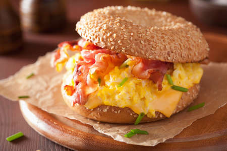 bacon and eggs: breakfast sandwich on bagel with egg bacon cheese