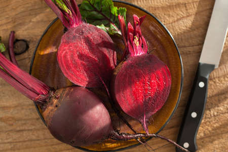 raw beetroot on wooden background Stock Photo