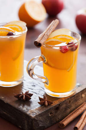 punch spice: hot apple orange cider with cinnamon spice warming drink Stock Photo