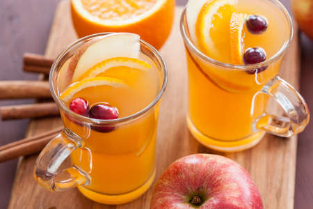 hot drink: hot apple orange cider with cinnamon spice warming drink Stock Photo