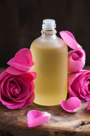 essential oil and rose flowers aromatherapy spa perfumery Stock Photo