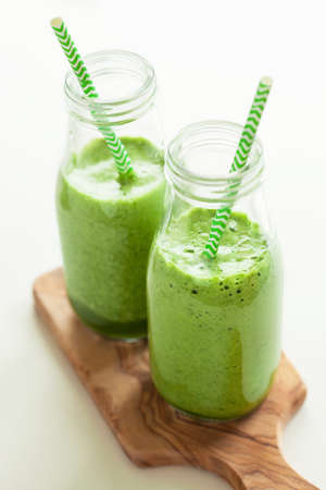 healthy green spinach smoothie with cilantro lime banana ginger Stock Photo