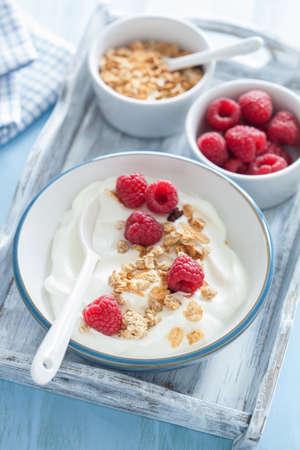 yogurt with granola and raspberry for healthy breakfast Stock Photo