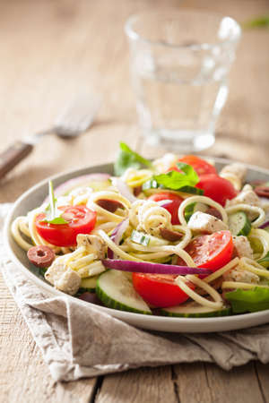 spiralized courgette salad greek style with tomato feta olives cucumber