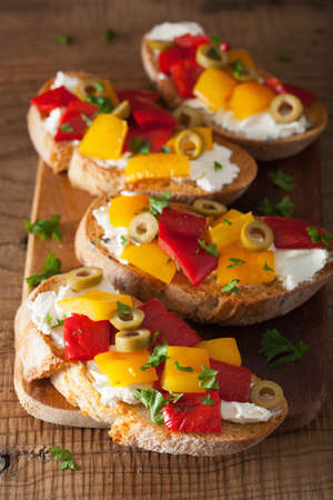 italian bruschetta with roasted peppers goat cheese olives