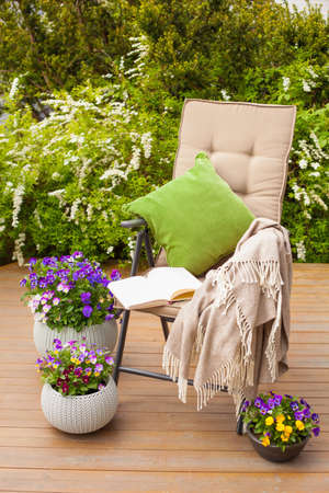 garden chair on terrace, relax, flowers, bush