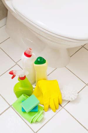 cleaning items gloves brush white toilet bowl bathroom