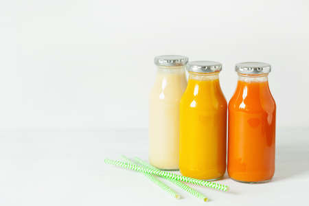 banana: fruit and vegetable smoothies in glass jars, orange mango banana carrot pineapple