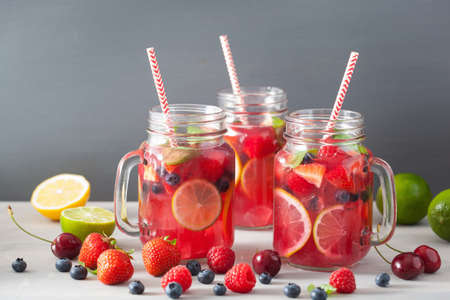 summer berry lemonade with lime and mint in mason jar Stok Fotoğraf