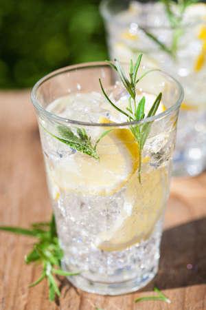refreshing lemonade drink with rosemary in glasses Stok Fotoğraf - 82999065