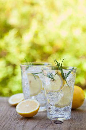 refreshing lemonade drink with rosemary in glasses Stok Fotoğraf - 82944992