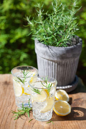 refreshing lemonade drink with rosemary in glasses Stok Fotoğraf - 82999068