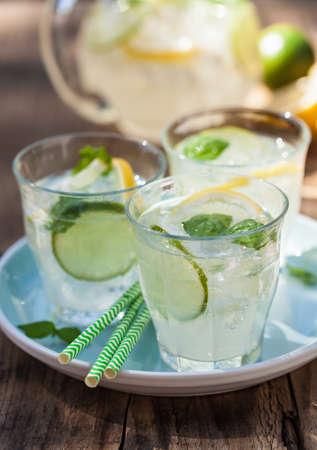 refreshing lemonade drink with mint lime lemon in garden Stock Photo