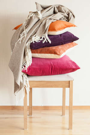 colorful cushions on chair cozy home mood Stock Photo