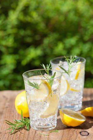 refreshing lemonade drink with rosemary in glasses Stok Fotoğraf - 84549141