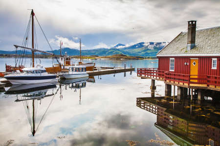 traditional fisherman houses rorbu and boats at Haholmen island, Norway
