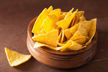mexican nacho chips on brown background Stock Photo