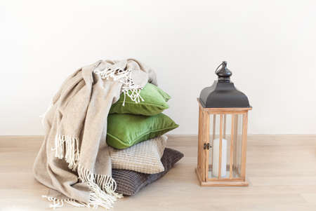 gray and green cushions cozy home interior Stock Photo