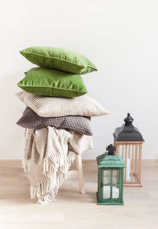gray and green cushions cozy home Фото со стока - 85691075