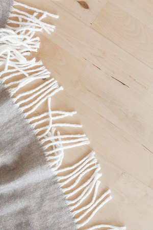 warm wool throw plaid on wooden background 版權商用圖片