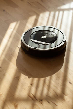 robotic vacuum cleaner on laminate wood floor smart cleaning technology