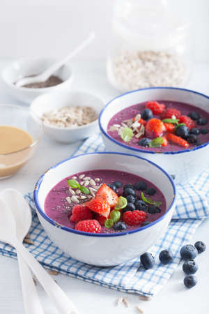 healthy berry smoothie bowl with strawberry blueberry raspberry and chia seed Stock Photo - 95234149