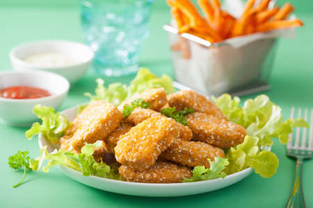 vegan soy nuggets and sweet potato fries healthy meal Stock Photo