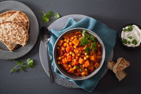sweet potato and chickpea curry with naan bread Stock Photo - 96762078