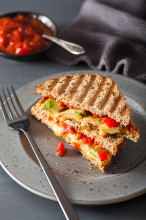 grilled cheese sandwich with avocado and tomato Фото со стока