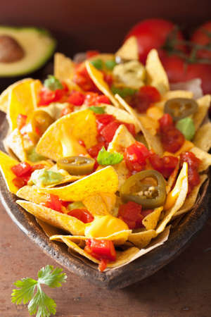 nachos loaded with salsa, cheese and jalapeno Stock Photo