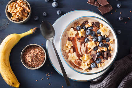 healthy banana smoothie bowl with blueberry chocolate walnuts Stock Photo